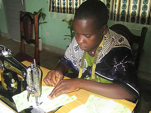 One of the tailors in the AIDS Orphan Sewing Project in Tanzania.