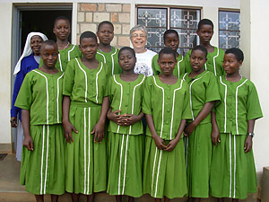 Sister Stella with the girls of the AIDS Orphan Sewing Project in Tanzania.